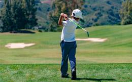 Boy playing golf at La Cala